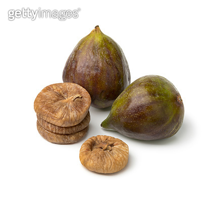 Fresh ripe figs and a heap of dried ones