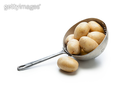 Raw potatoes in a metal colander isolated on white background