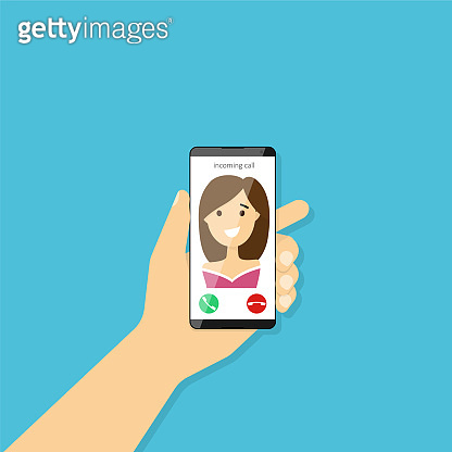 Incoming call on smartphone screen. Hand holding smartphone
