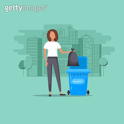 Girl throws garbage in the trash