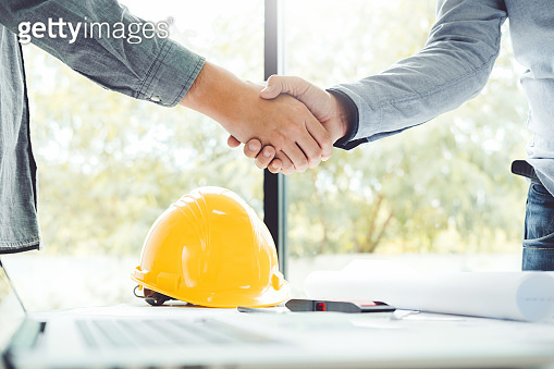 Engineer meeting for architectural project and working with partner engineering on workplace