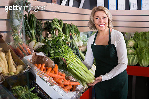 Mature woman selling vegetables