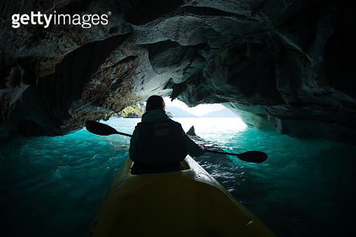 Woman paddles kayak