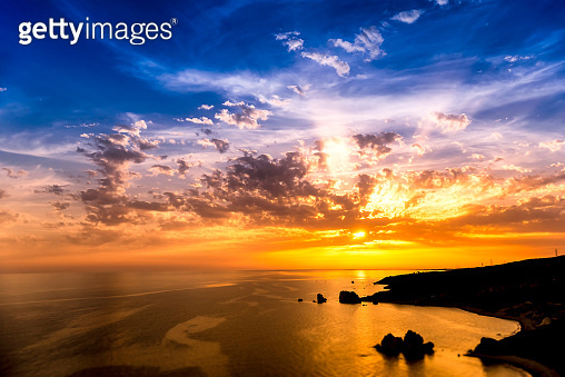 Dramatic sunset over Aphrodite's Rock also known as Rock of the Greek. Paphos District, Cyprus
