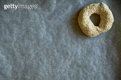 Bagel prepared for baking on baking paper
