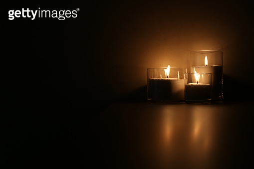 Still Life of Burning Candles in the Darkness. Loose Wax