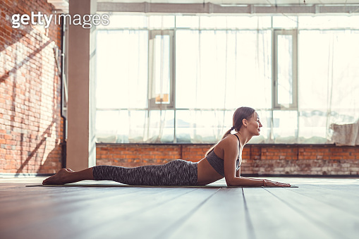 Young woman practicing pilates