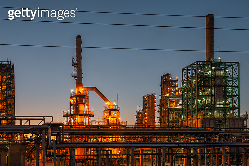 Oil refinery industrial plant or factory panorama, storage distillery tanks and steel pipeline, modern petrochemical technologies