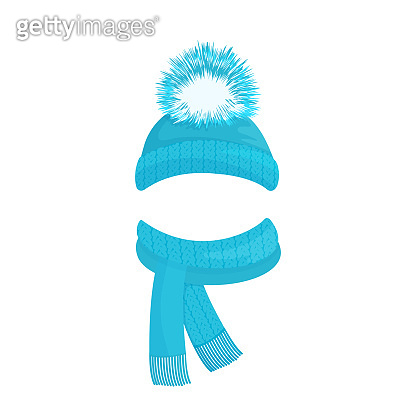 Winter knitted blue hat with a pompom and a scarf with fringe