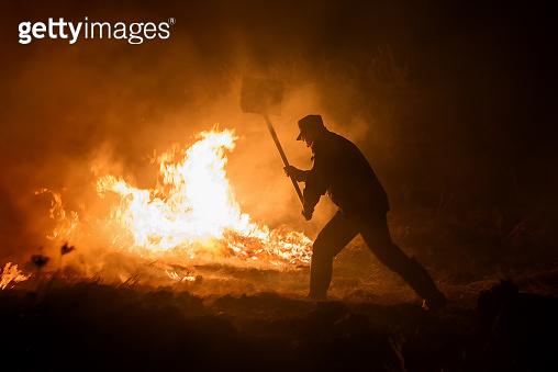 Tulcea, Romania. Sept 28th, 2017. Firefighter try to extinguish a fire that broke out hills.