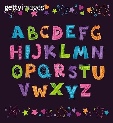 Cute funny childish alphabet on the dark background.