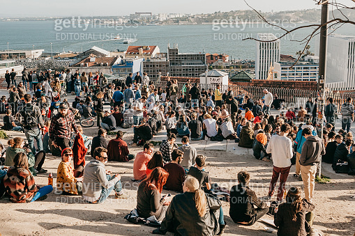 Many young people of local people, tourists and migrants on the city lookout platform which is a meeting place for young people and communication between them
