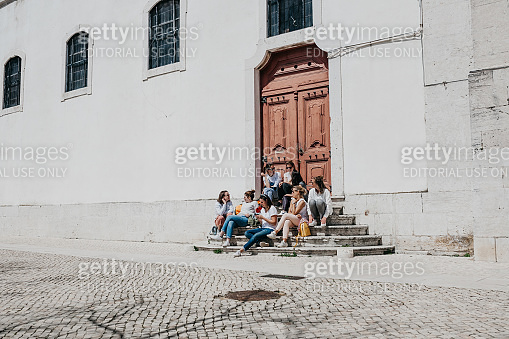 A group of teenage girls or students or girlfriends sit together and talk