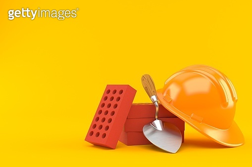 Trowel and bricks with hardhat