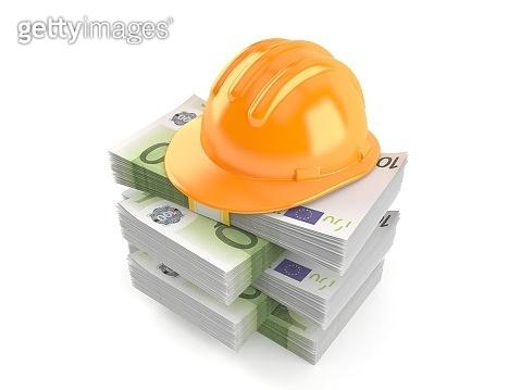 Hardhat on stack of money