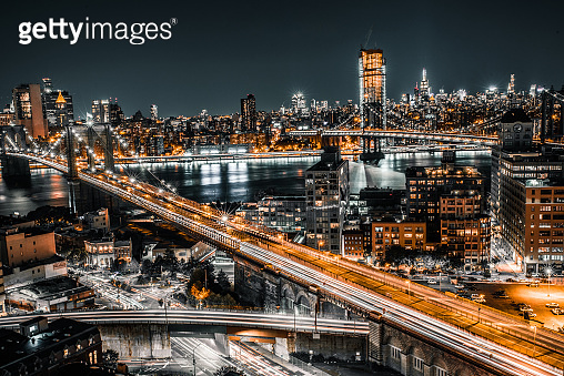 Long exposure of the entire Brooklyn Bridge with the night time rush in view