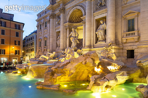 Beautiful architecture of the Trevi Fountain in Rome at dusk