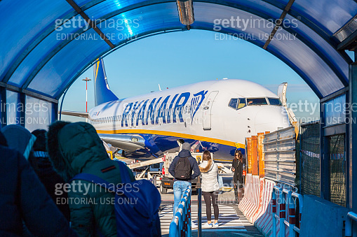 People waiting for boarding to Ryanair plane on Ciampino Airport near Rome.