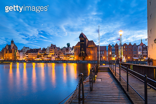 Beautiful old town in Gdansk over Motlawa river at dusk