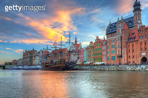 Beautiful port crane and the old town of Gdansk at sunset