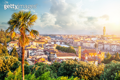 Florence panorama. Dawn and cityscape skyline of Florence Italy with Signoria and the Ponte Vecchio bridge over the river Arno.