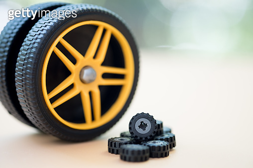 Miniature tire. Concept of car maintenance and service center. Vehicle tire repair and replacement equipment.