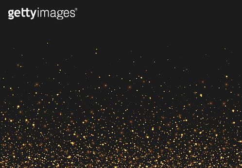 Golden glitter light effect. Background bright shining confetti particles.