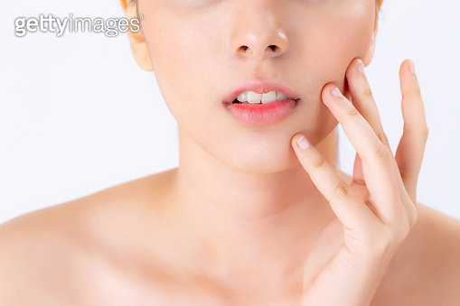 Closeup beautiful woman asian makeup of cosmetic, girl hand touch cheek and smile attractive, face of beauty perfect with wellness isolated on white background with skin healthcare concept.