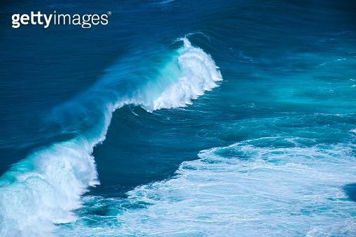 Splashing waves near the coastline