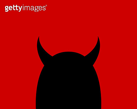 Cartoon devil character on a red background. Silhouette of a black horned head.