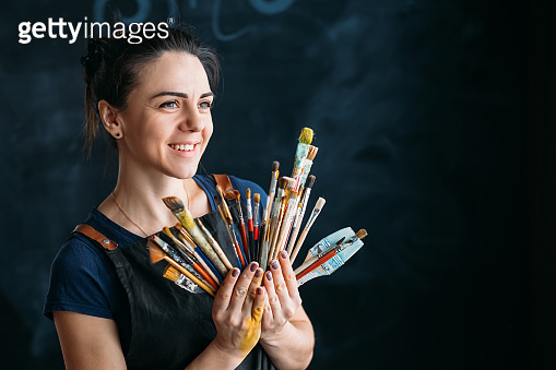 artist supplies artwork young woman paintbrushes