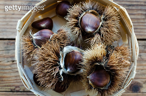 Chestnuts on wooden background