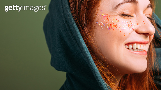 woman emotion smiling eyes closed glitter freckles