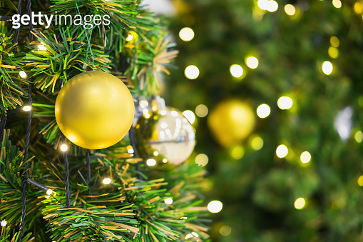 Closeup of Christmas-tree background and Christmas decorations with snow, blurred,bokeh. Happy New Year and Xmas theme