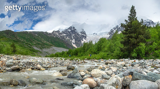 Wild mountains Tetnuldi and Gistola over glacier Lardaad. Svaneti mountain landscape