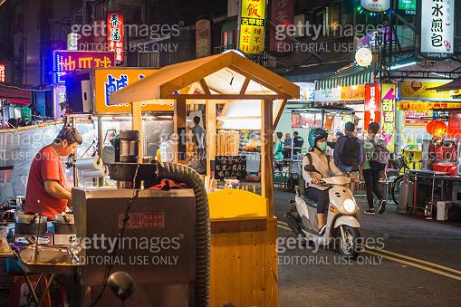 Taipei night market street food stalls and scooters Taiwan