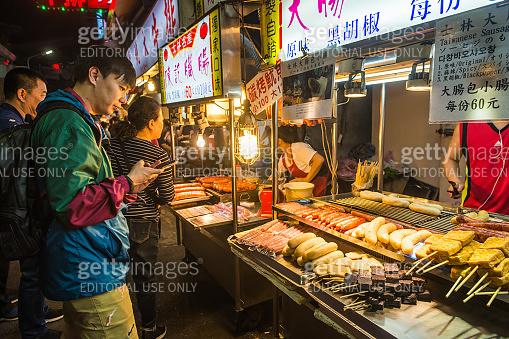 Taipei cooks customers traditional street food stall night market Taiwan