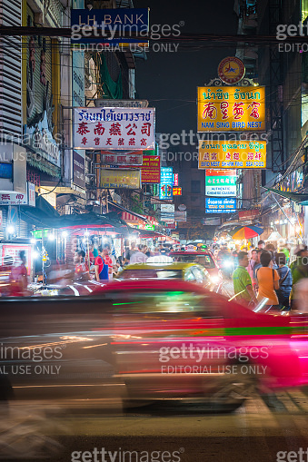 Bangkok busy streets night market people and traffic Chinatown Thailand