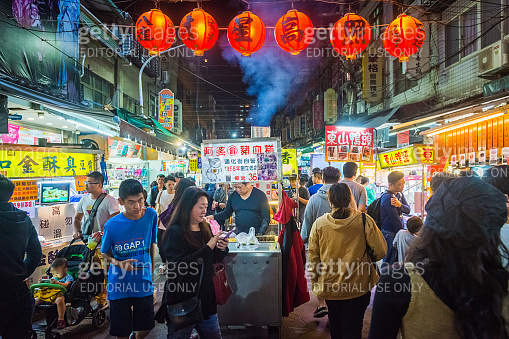 Taipei crowds of shoppers at busy night market stalls Taiwan