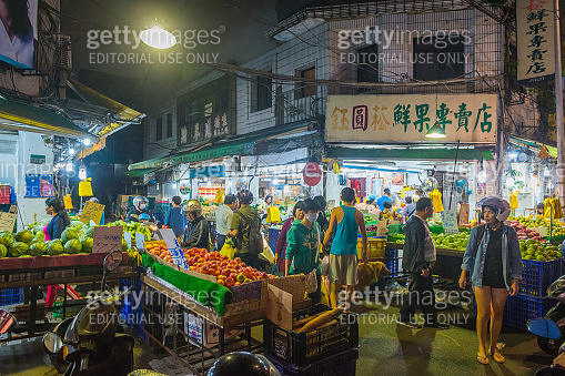 Taipei people shopping for groceries at busy night market Taiwan