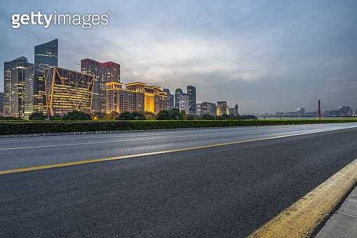 night view of urban traffic road with cityscape in background, China