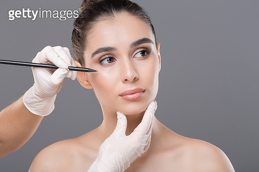 Young woman getting ready for face lifting