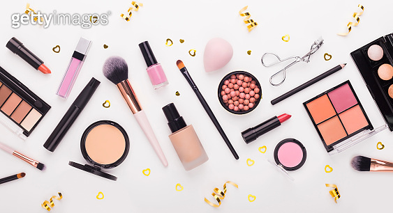Flat lay of beauty accessories and decorative cosmetics on white