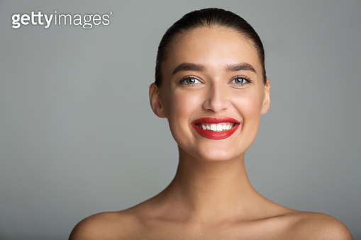 Teeth Whitening. Beautiful Woman with Red Lips