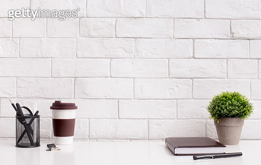 Modern and stylish office desktop with coffee to go and supplies
