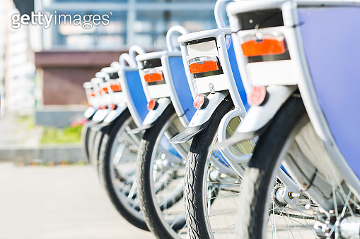 Bicycles for rent in city, close up of wheels outdoor