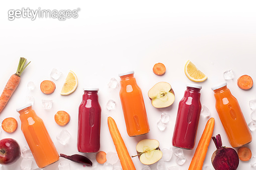 Organic detox cocktails with fresh fruits on white background