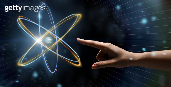 Female hand reaching to glowing atom projection