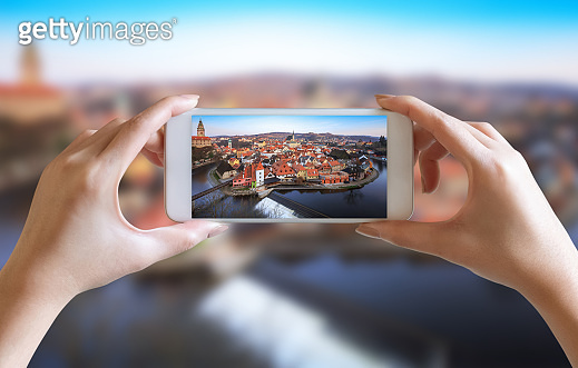 hands take photo of village scenery view with mobile smartphone