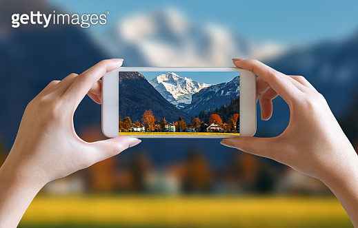 hands take photo of nice mountain and sky scenery view with mobile smartphone